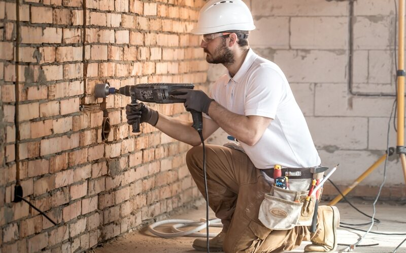handyman-uses-jackhammer-installation-professional-worker-construction-site-concept-electrician-handyman